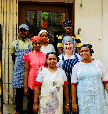 Peaches pictured with staff from HOPE Café